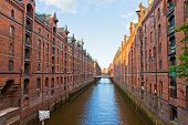 Famous Speicherstadt disctrict in Hamburg Germany. This largest warehouse district in the world received the UNESCO world heritage status in July 2015 poster