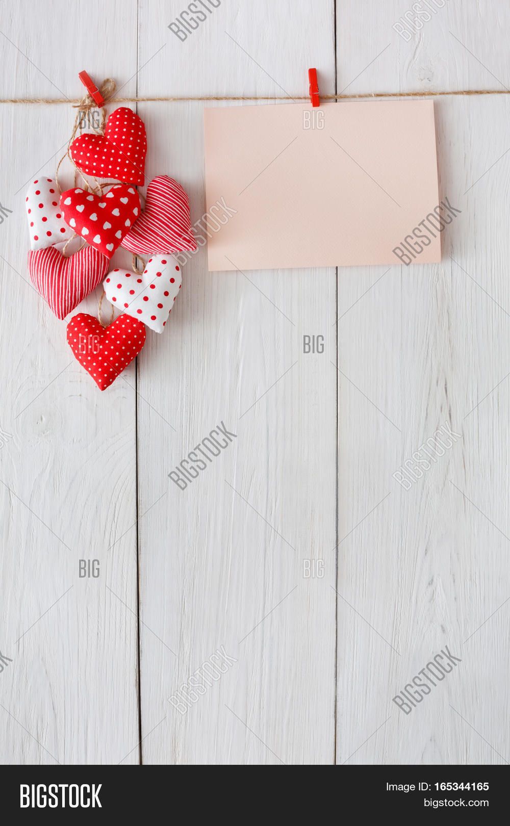 Valentine Background With Sewed Pillow Diy Handmade Hearts And Empty Greeting Card On Red Clothespins At