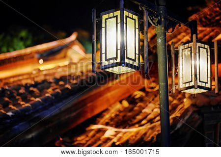 Night View Of Street Lamp And Traditional Chinese Tile Roofs