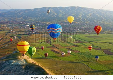 Cappadocia. Colorful hot air balloons flying over the valley at Cappadocia Anatolia Turkey. Volcanic mountains in Goreme national park.