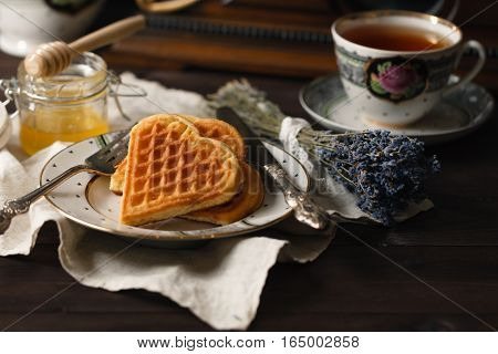 Viennese wafers with tea cup and honey