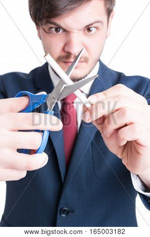 Selective Focus Of Mad Man Cutting One Cigarette