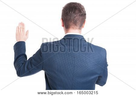 Back View Of Politician Standing Raising Hand Taking Oath