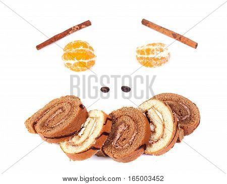 Tasty cake roll and clementine isolated on a white background