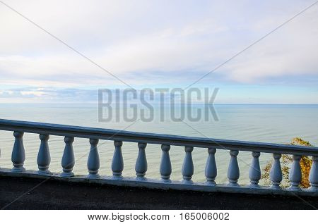 Railing overlooking the sea in a botanical garden. Batumi. Georgia.