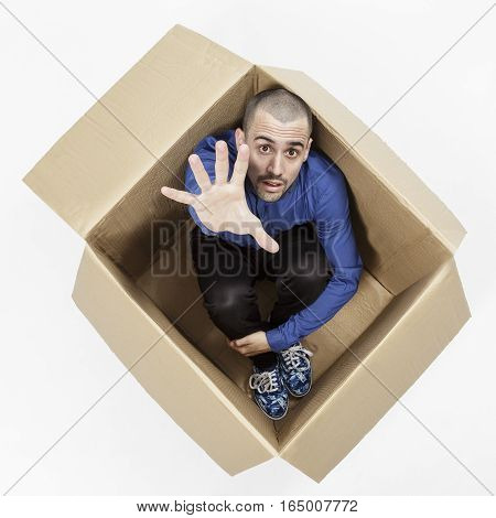 Man in a cardboard box on a white background