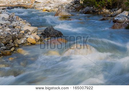 Natural wild stream in the mountains in daylight