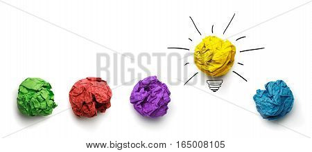 Great idea standing out of the crowd concept. Crumpled paper as symbol of a light bulb idea isolated on white background