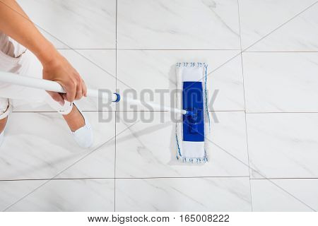 High Angle View Of Cleaning Service Woman Mopping The Kitchen Floor