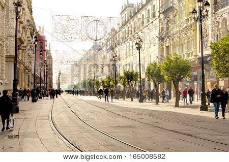 Seville, Spain - January 4, 2017: the main street, Avenida de La Constitution in winter, Seville, Spain