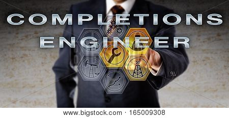 Recruiter in blue business suit is pushing COMPLETIONS ENGINEER on an interactive computer screen. Oil and gas industrial job metaphor for an engineering role in technical support for well planning.