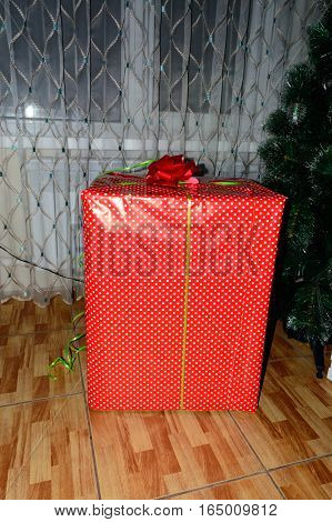 New Year gifts. Red box with gifts for the new year. The traditional preparation of gifts under the Christmas tree in New Year's Eve