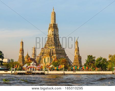 Chao Phraya River and Wat Arun Temple at sunrise. Bangkok, Thailand