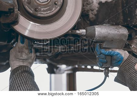 Hands Of Car Mechanic In Auto Repair Service.