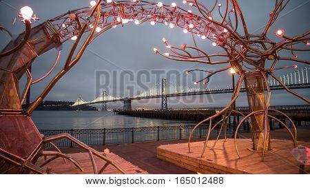 SAN FRANCISCO, CA - September 02, 2014: Oakland-bay Bridge from the lights near Pier 14 at night, San Francisco
