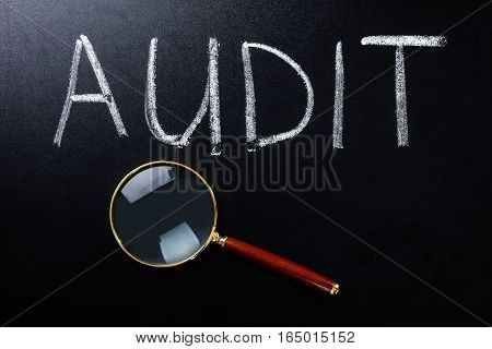 Close-up Of Audit Concept With Magnifying Glass