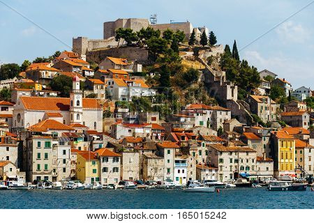 day view of the historical part with old houses and St. Michael's fortress in Sibenik, Croatia.