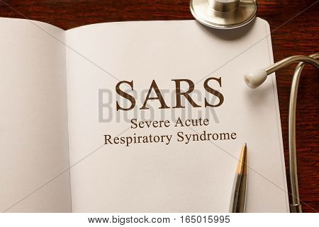 Page With Sars Severe Acute Respiratory Syndrome ,on The Table With Stethoscope, Medical Concept