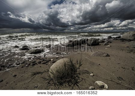 stormy beach windy waves clouds sea sand