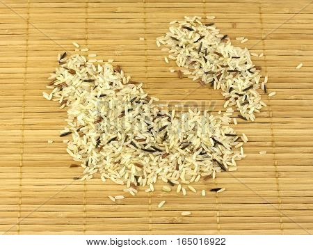 China color rice seeds on brown straw mat closeup