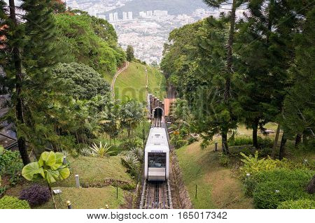 A funicular train on it's way up to Penang Hill Malaysia