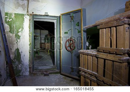 Hermetic door of an abandoned Soviet bomb shelter, and box with gas masks, an echo of the Cold War, Voronezh, Russia
