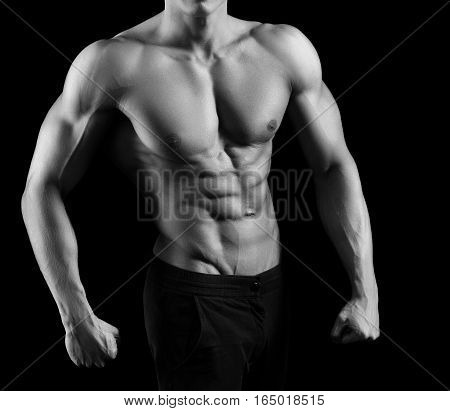 Every inch is perfect. Cropped monochrome shot of a fit and toned man posing shirtless