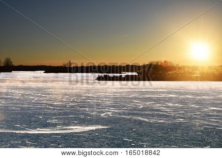 The peat bogs of Lake Iseo at sunset completely frozen - Brescia - Lombardy - Italy
