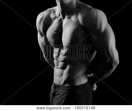 Athlete soul. Black and white cropped shot of a male bodybuilder showing off his muscles