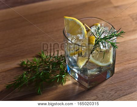 Gin With Lemon, Ice And  Juniper Branch
