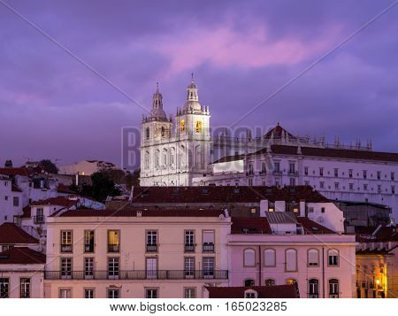 LISBON PORTUGAL - JANUARY 10 2017: Church of Sao Vicente of Fora in Lisbon Portugal seen from Portas do Sol by night.