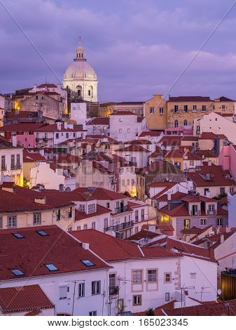 LISBON PORTUGAL - JANUARY 10 2017: Cityscape of Lisbon Portugal seen from Portas do Sol by night.