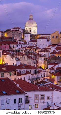 LISBON PORTUGAL - JANUARY 10 2017: Cityscape of Lisbon, Portugal, with the National Pantheon, seen from Portas do Sol by night.