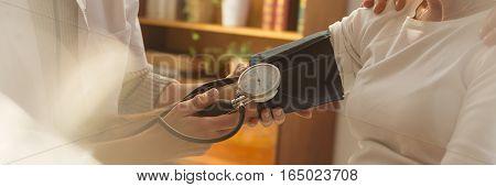 Patient During Measuring Blood Pressure