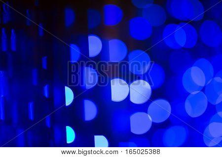 Blue defocused christmas or holiday lights background.