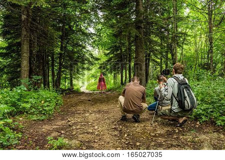 Group of wildlife and outdoor photographer with dslr camera shooting landscape with model