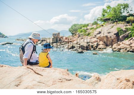 Father And Son Travelers At The Hon Chong Cape, Garden Stone, Popular Tourist Destinations At Nha Tr