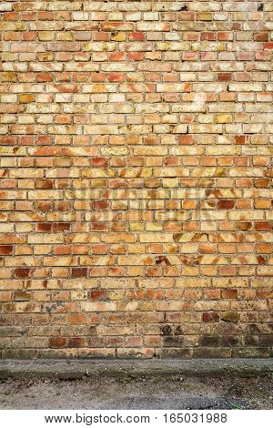 Yellow brick wall background with concrete basement