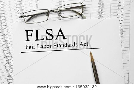 Paper With Fair Labor Standarts Act Flsa On A Table