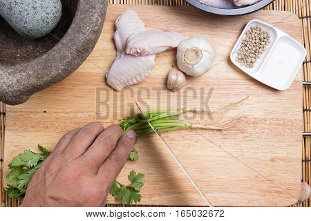Chef cutting coriander with knife / cooking fried chicken wings concepted