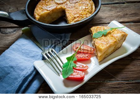 Spanish potato omelette portion on white tray