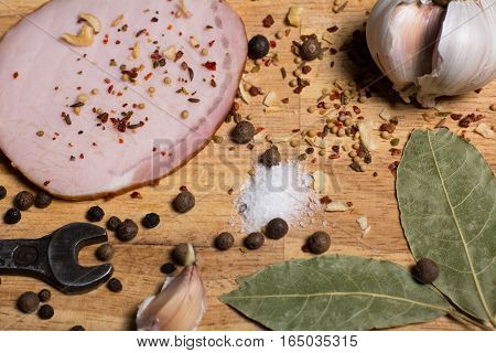 Spices On Chopping Board, Bacon And A Wrench