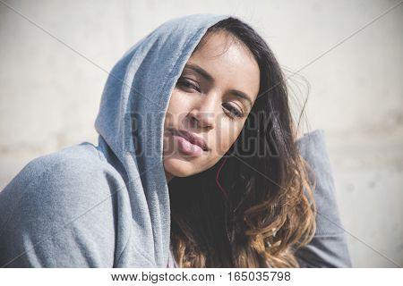 Portrait of beautiful woman listening music with headphones