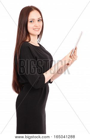 Happy student teenage girl keeps tablet pc standing sideways isolated on white