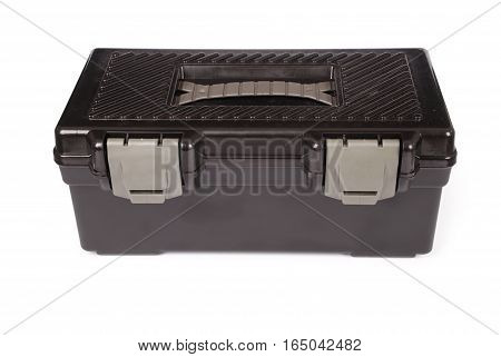 Black closed toolbox isolated on white background with soft shadow (Clipping path)