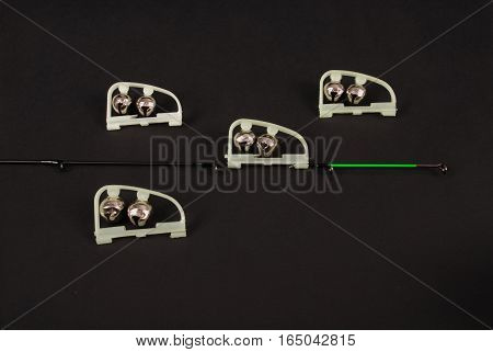 Fishing green LED power indicator (attached to the tip of the feeder) isolated on black background. Clipping path