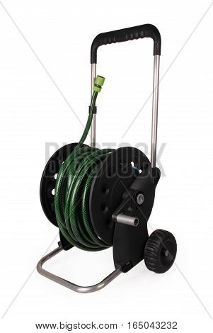 Carrying a black for hose with a green hose isolated white background with soft shadow. Cose-up