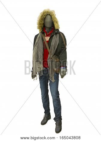 Full-length male mannequin dressed in warm jacket with hood and blue jeans isolated on white background. No brand names or copyright objects.