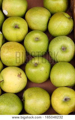 Green apples for sale in a greengrocery