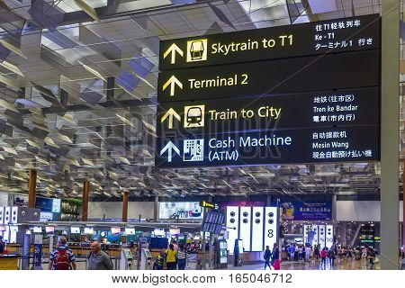 Singapore - January 8, 2017: Visitors walk around Departure Hall in Changi Airport. It has 3 passenger terminals, and is one of the largest transportation hubs in Asia and serves more than 100 airlines.